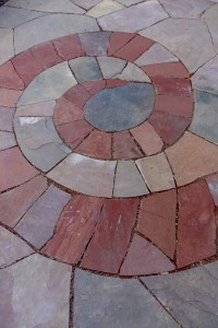 Different color flagstone used in a spiral pattern